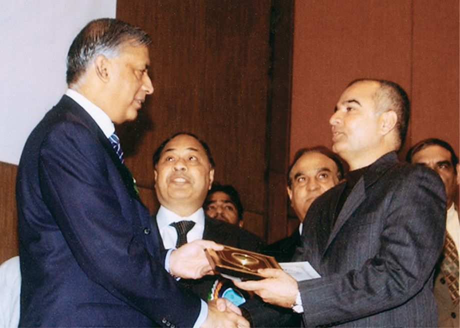 <b>2004</b> Receiving Special Merit Trophy from Prime Minister Shaukat Aziz